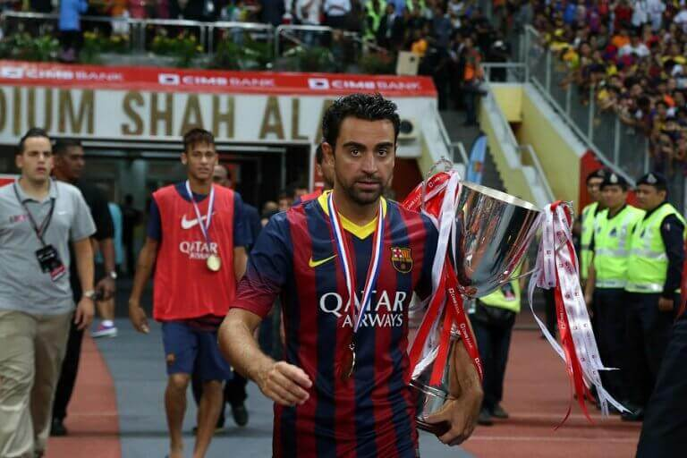 Xavi Hernández holding one of his many trophies