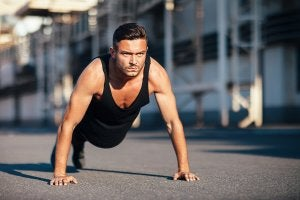 Push-ups, one of the classic bodyweight exercises for men.