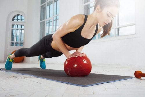 Chest push-ups can also be done on a medicine ball dynamic workout routine.