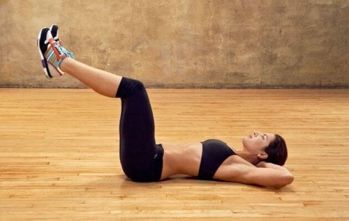 The inverted crunch consists of lying on your back with your arms at each side of your body for dynamic workout routine.