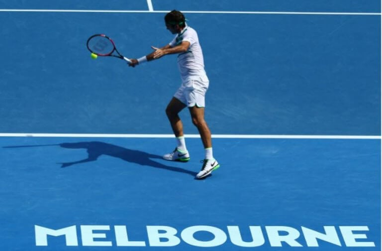A professional tennis player in the middle of a game for the Australian Open