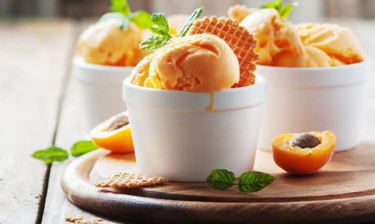 3 bowls of apricot ice cream to illustrate the recipe.