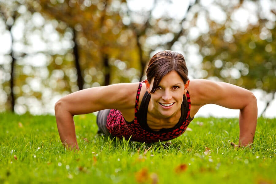 Woman push-ups to strengthen breast area