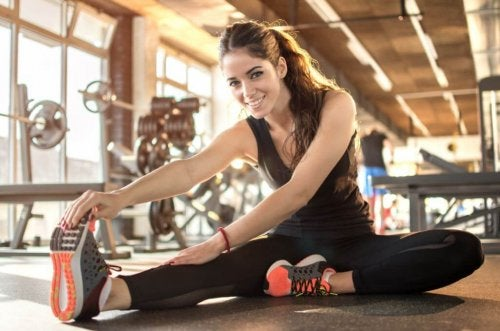 A woman stretching in a gym.