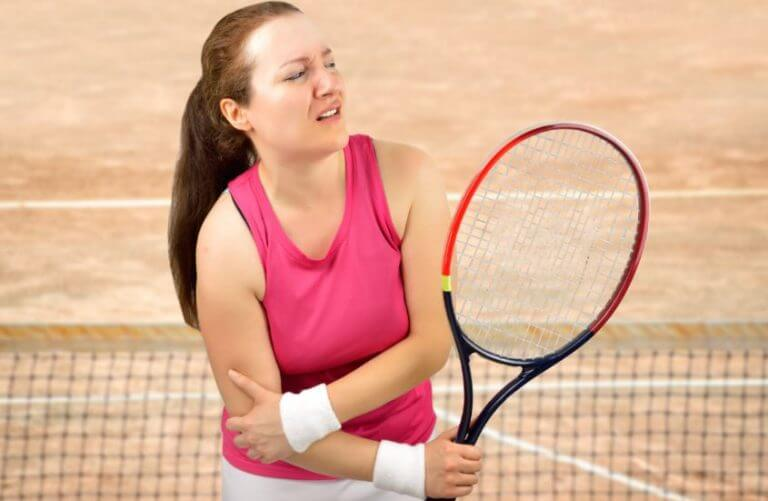 A tennis player with some type of sport injury in her elbow