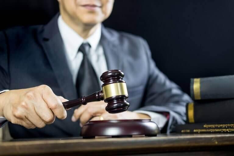 A man holding a judge hammer