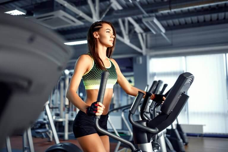 Woman on an elliptical machine illustrated part of a daily training routine