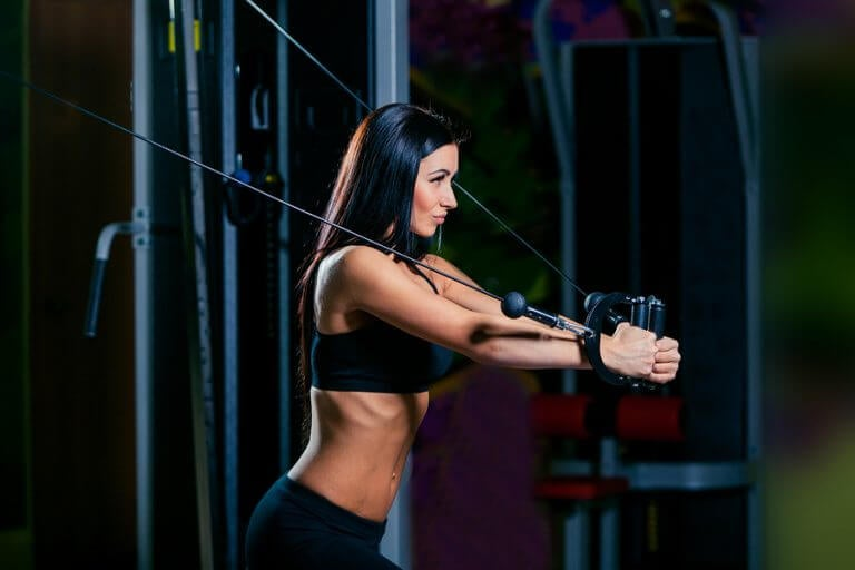 Woman doing horizontal pulley exercises to get fit for ski