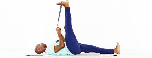 A man using resistance bands to do leg stretches