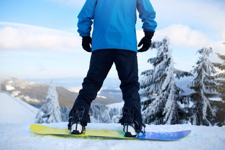 A person doing board sports in the snow