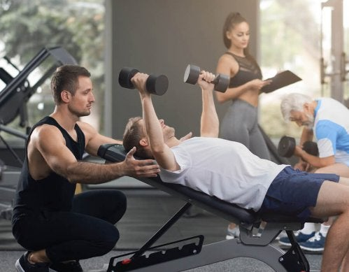 A man performing an incline dumbbell press.