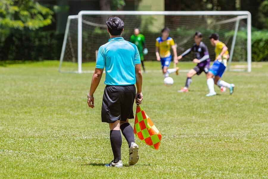 A soccer referee must pass theoretical and practical exams before he can practice.