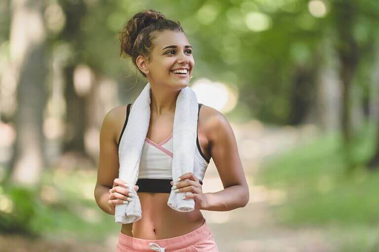 A woman smiling after her morning workout