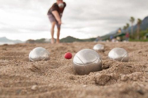 A man playing bowls.