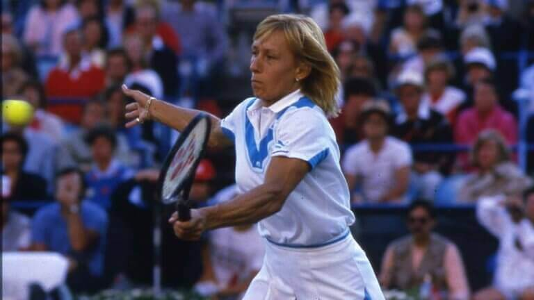 Martina Navratilova playing tennis as described in the text.