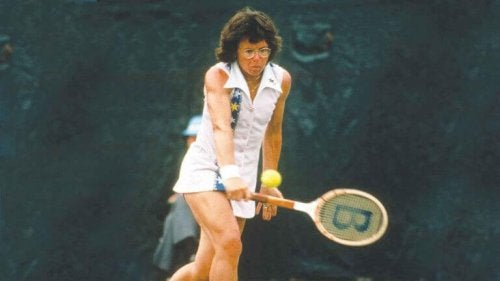 Billie Jean King on court, supporting the subject of the text