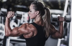 A female bodybuilder lifting weights.