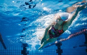 A woman swimming in a pool.