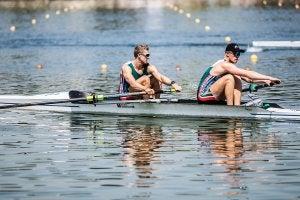 Two men rowing.