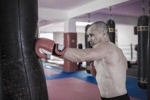 A man punching a punching bag.