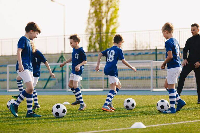 Children playing small sided soccer games