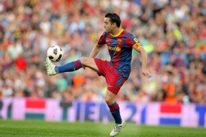 A player kicking a soccer ball.