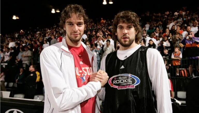 The Gasol brothers holding hands after a basketball game