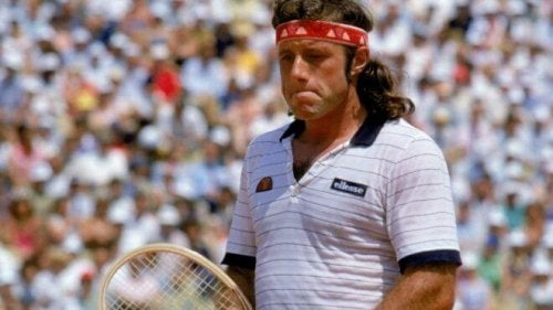Guillermo vilas with a racket in his hand.