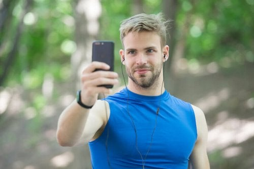 A man taking a selfie with a phone.