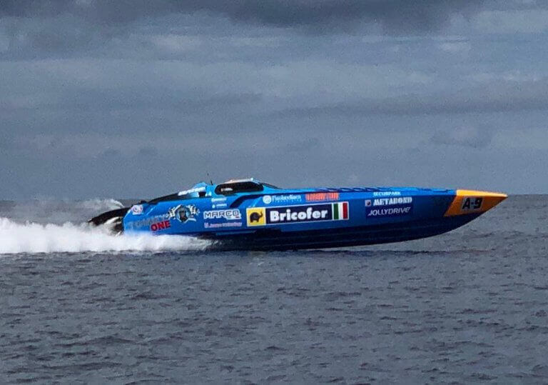 A power boating vehicle racing through the ocean
