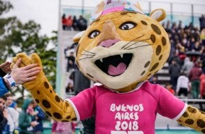 The mascot is typically a native animal from the organizing country.