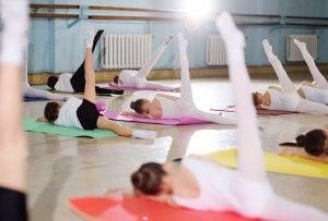 Children stretching in a ballet class.