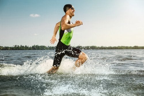 A man embodying the olympic spirit by improving his running speed.