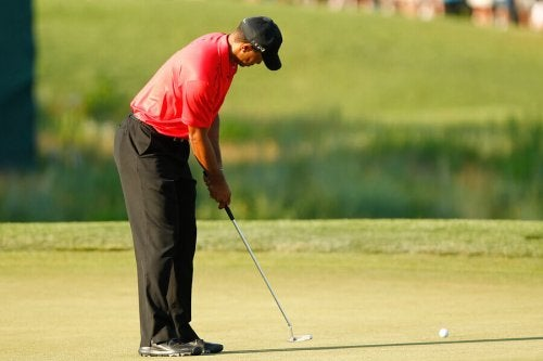 Tiger Woods hitting a ball.