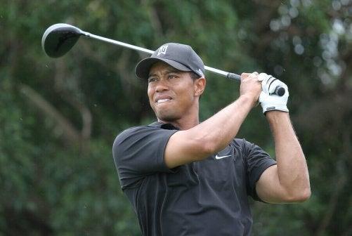 Tiger Woods swinging a golf club.