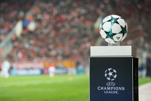 The uefa champions league ball on a podium.