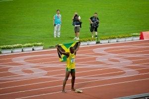 Usain Bolt with the Jamaican flag.