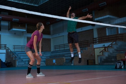 A man about to spike in volleyball.