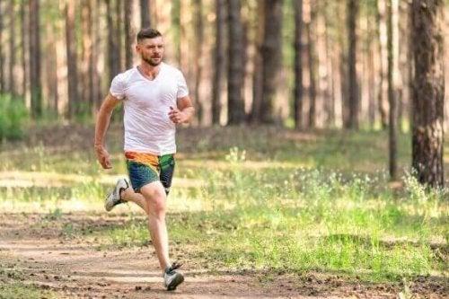 A man running through the woods.