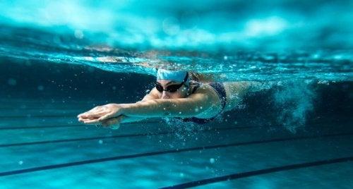 A woman enjoying the benefits of swimming.