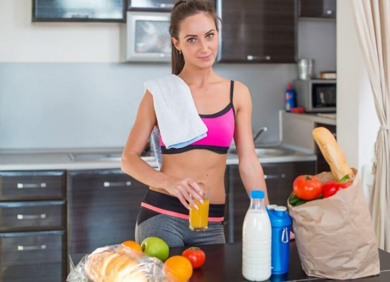 A woman putting away her healthy groceries after doing HIIT