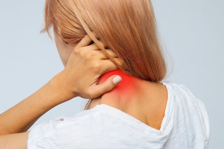 A woman with back and neck pain due to a herniated disk