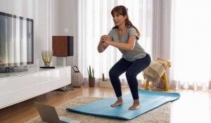 A woman performing squats.