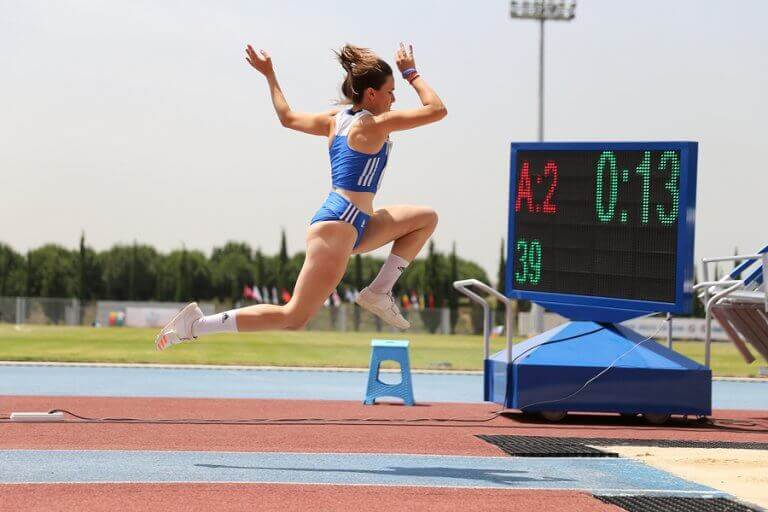 A woman jumping during the Olympic games