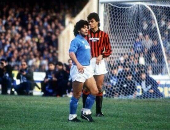 Paolo Maldini next to Diego Maradona in the middle of a stadium