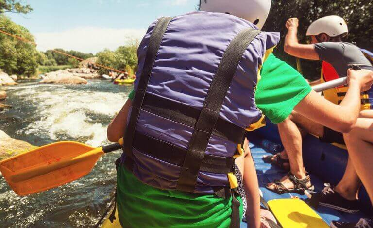 A rafting team going down a river