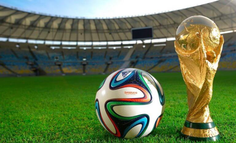 FIFA soccer world cup trophy next to a ball
