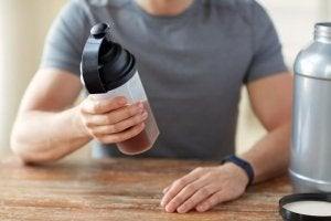A man examining a protein shake.