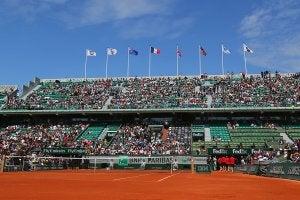 A clay tennis court during a tournament.