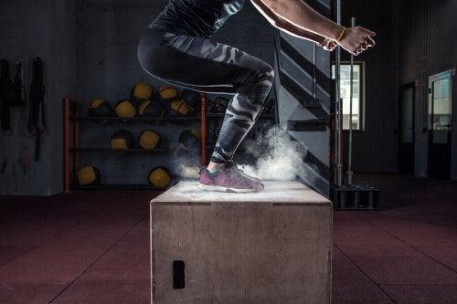 A woman doing a box jump.
